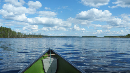 canoeing at beautiful finnish lakescape in summer Stock Photo
