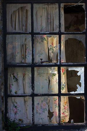 burgler: A window with all panes broken by vandals.