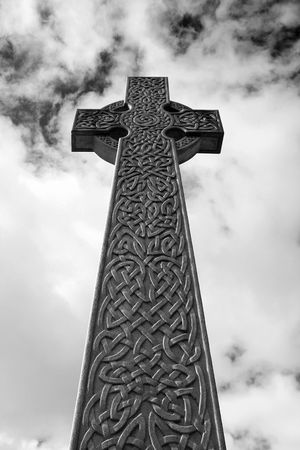 celtic mythology: A celtic cross photographed in black and white giving it an eerie atmosphere.
