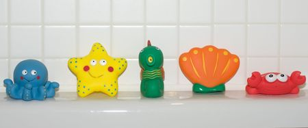 A Line of Colourful Bath Toys Stock Photo - 4832901