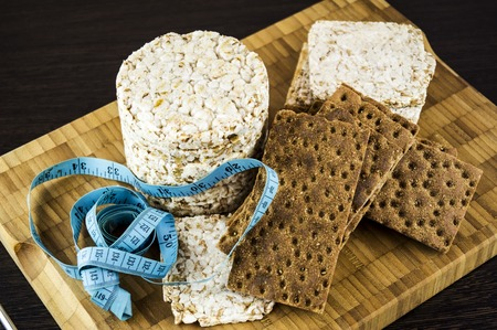 eating right: crispbread and ruler, bread products Stock Photo