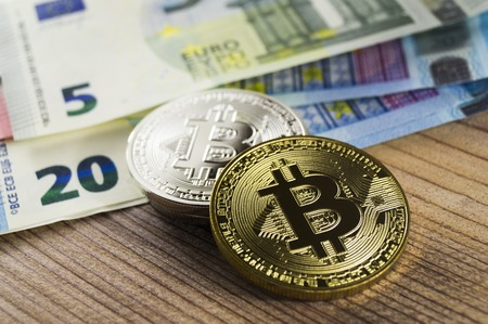 electronic commerce: Bitcoin is a modern way of exchange and this crypto currency is a convenient means of payment in the financial Stock Photo
