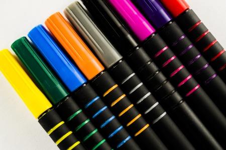Felt pens close-up on white sheet of paper background Stock Photo