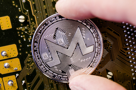 Monero is a modern way of exchange and this crypto currency is a convenient means of payment in the financial and web markets Archivio Fotografico - 98491111