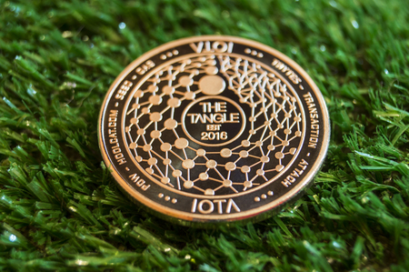 iota is a modern way of exchange and this crypto currency is a convenient means of payment in the financial Stock Photo