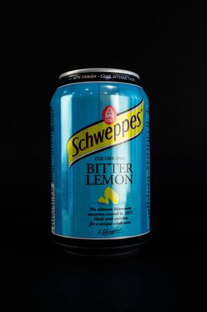 Omsk, Russia - November 27, 2019: Image of a can of carbonated drink Schweppeson a dark background