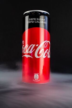 Omsk, Russia - November 27, 2019: Image of a can of carbonated drink coca-cola on a dark background