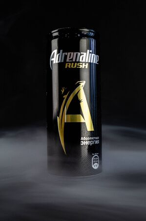 Omsk, Russia - November 27, 2019: Image of a can of carbonated drink adrenaline rush on a dark background 新闻类图片