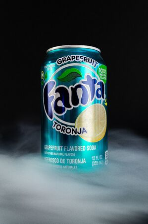 Omsk, Russia - November 27, 2019: Image of a can of carbonated drink Fanta on a dark background