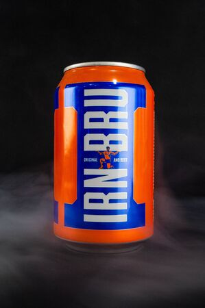 Omsk, Russia - November 27, 2019: Image of a can of carbonated drink Irn-Bru on a dark background