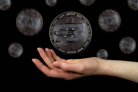 Elements of the dash cryptocurrency fall. Photo on a black background Banque d'images