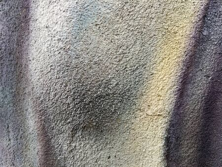 Drawing of multi-colored paint on a concrete wall. Beautiful background