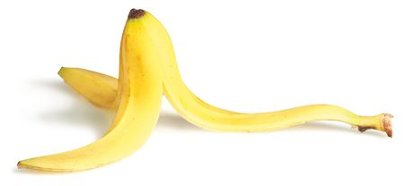 slippery banana skin on a white background