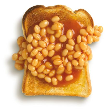 beans on toast, student meal on a white background shot from overhead Stock Photo