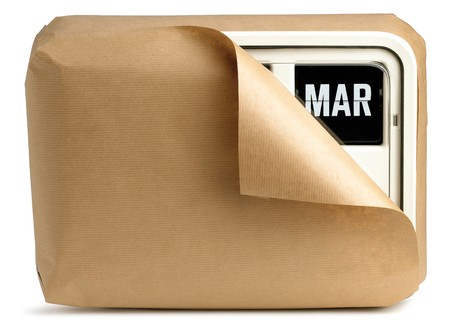 a March office clock calendar wrapped up in brown paper