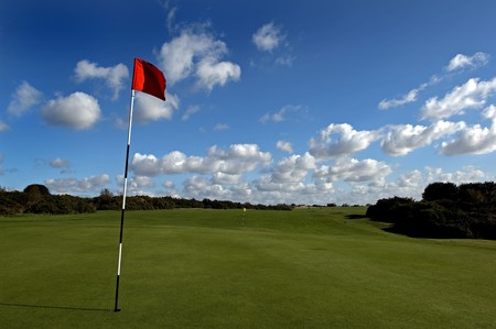 a beautiful golf course on a sunny day Stock Photo