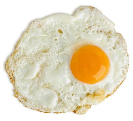 Greasy fried egg on white background Stock Photo