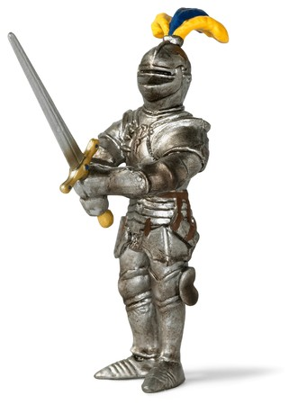 toy knight in shining armour brandishing his sword on a white background photo