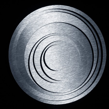 round metal concentric circles on a black background