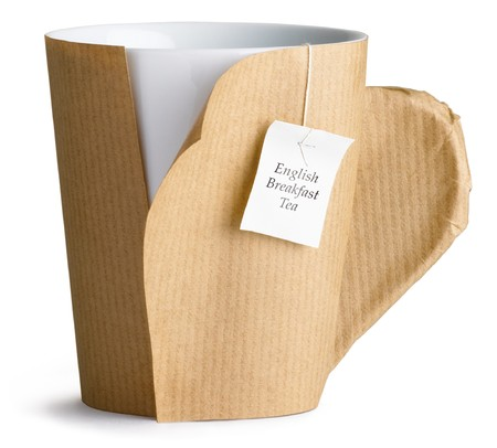 a coffee , tea cup, mug wrapped up in brown paper