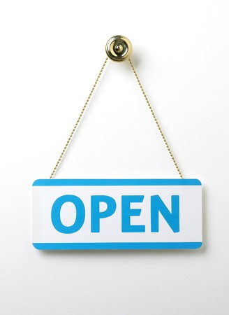 a process blue open door sign on a brass chain on a white background