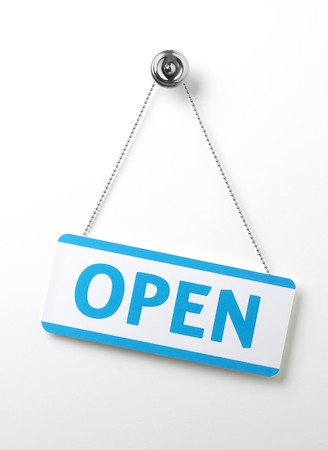 a process blue angled open door sign on a silver chain on a white background
