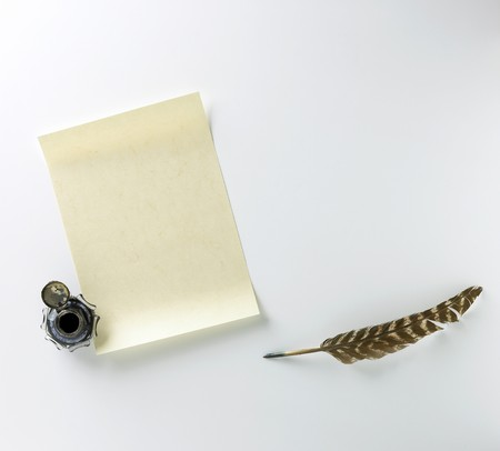 a blank letter, ink and feather quill on a white background 2 photo