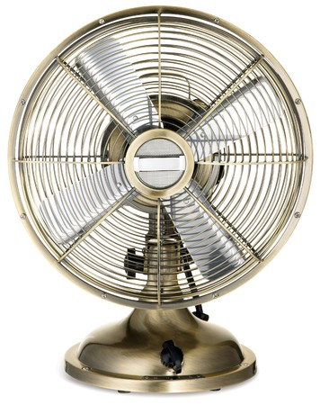 old fashioned retro silver and brass desktop fan  on a white background Stock Photo