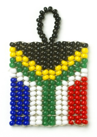 south african flag: a south african flag keyring from above on a white background