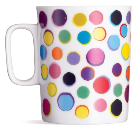 fun spotty coffee tea mug on a white background Stock Photo