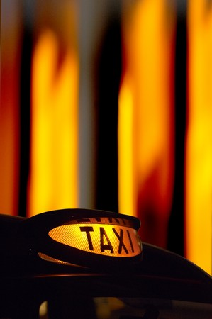 a british london black taxi cab sign at night with colorful background 3