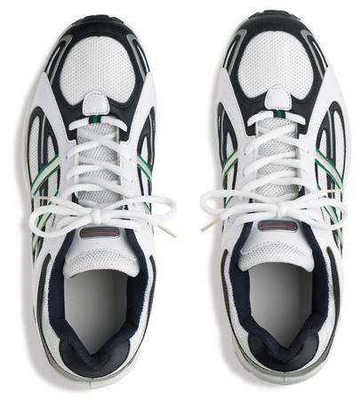 unbranded pair of running shoes trainers on a white background Stock Photo