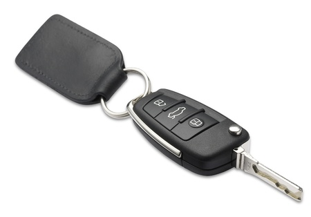 a car key and fob with shallow depth of field on white with clipping path