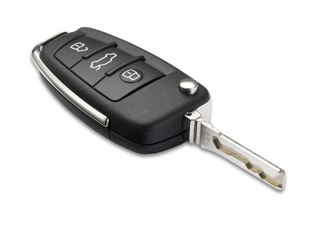 a car key with shallow depth of field on white with clipping path