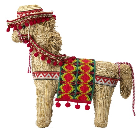 side view of a straw  spanish donkey with clipping path isolated on white