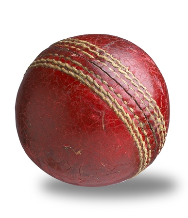 stitching: an old worn used cricket ball isolated on white with clipping path