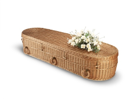 a wicker bio-degradable eco coffin isolated on white with clipping path