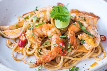 Spicy spaghetti with shrimps Banco de Imagens