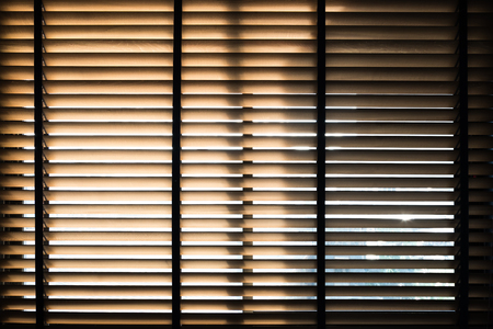 Sunlight behide vertical blinds window with shadow
