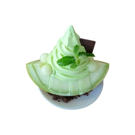 Sliced fresh Japanese melon topping with soft serve ice cream melon. Summer healthy dessert isolated on white background.