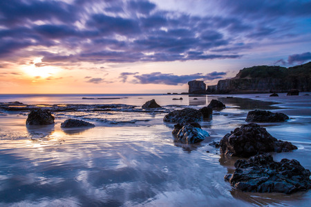 new zealand beach: Maori Bay at Sunset  Auckland, NEW ZEALAND