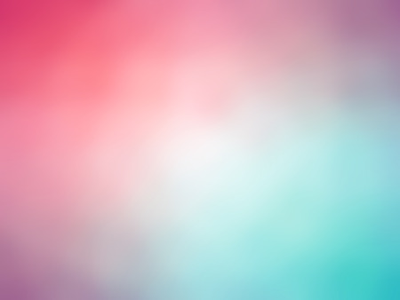 Gradient rainbow pink teal colored blurred background.
