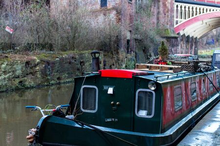 MANCHESTER, UNITED KINGDOM - 5 March, 2016: A houseboat on a canal in the city of Manchester in the north of England.