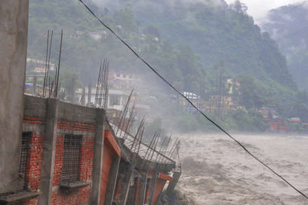 India Disaster. Heavy rainfall causes flood.Cause harm to many lives. Cloudburst in India. River flowing above red alert.