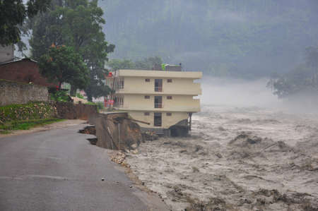 India Disaster. Heavy rainfall causes flood.Cause harm to many lives & property. Cloudburst in India. River flowing above red alert.