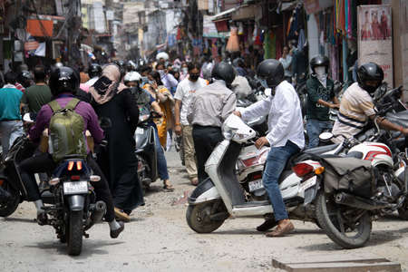Dehradun, Uttarakhand/India - September 06 2020:People going on the scooter wearing mask due to pandemic.