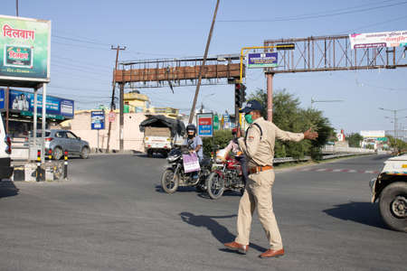 Dehradun, Uttarakhand/India - September 06 2020:Women police on duty, wearing face mask. Editoriali