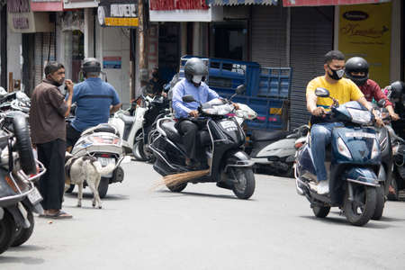 Dehradun, Uttarakhand/India - September 06 2020: People going on the scooter wearing mask due to pandemic.