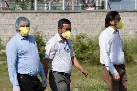 Dehradun, Uttarakhand/India - September 06 2020: Men going to their jobs, wearing N-95 Mask. Editoriali