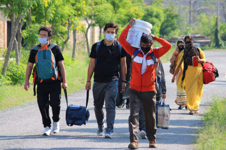 Dehradun, Uttarakhand/India - September 06 2020:Migrant people returning to their home due to corona pandemic. Editoriali